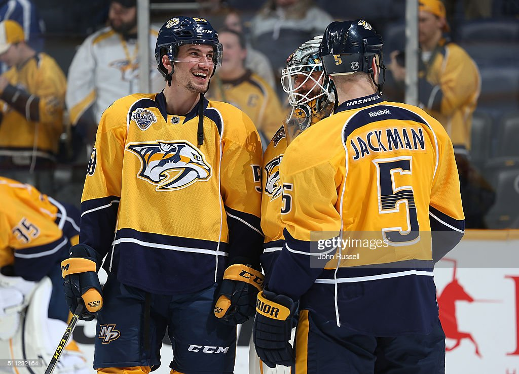 Roman Josi #59 of the Nashville Predators has a laugh with Carter Hutton #30 and Barret Jackman #5 during warmups prior to an NHL game against the Boston Bruins at Bridgestone Arena on February 18, 2016 in Nashville, Tennessee.