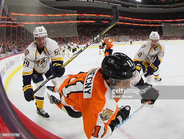 Roman Josi of the Nashville Predators hits Travis Konecny of the Philadelphia Flyers during the second period at the Wells Fargo Center on December...