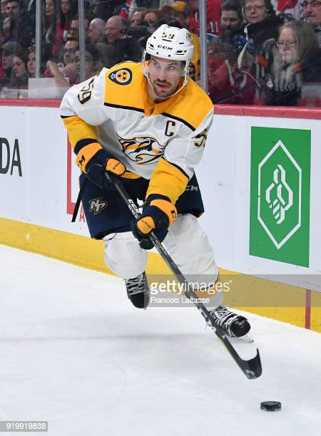 Roman Josi of the Nashville Predators looks to pass the puck against the Montreal Canadiens in the NHL game at the Bell Centre on February 10 2018 in...