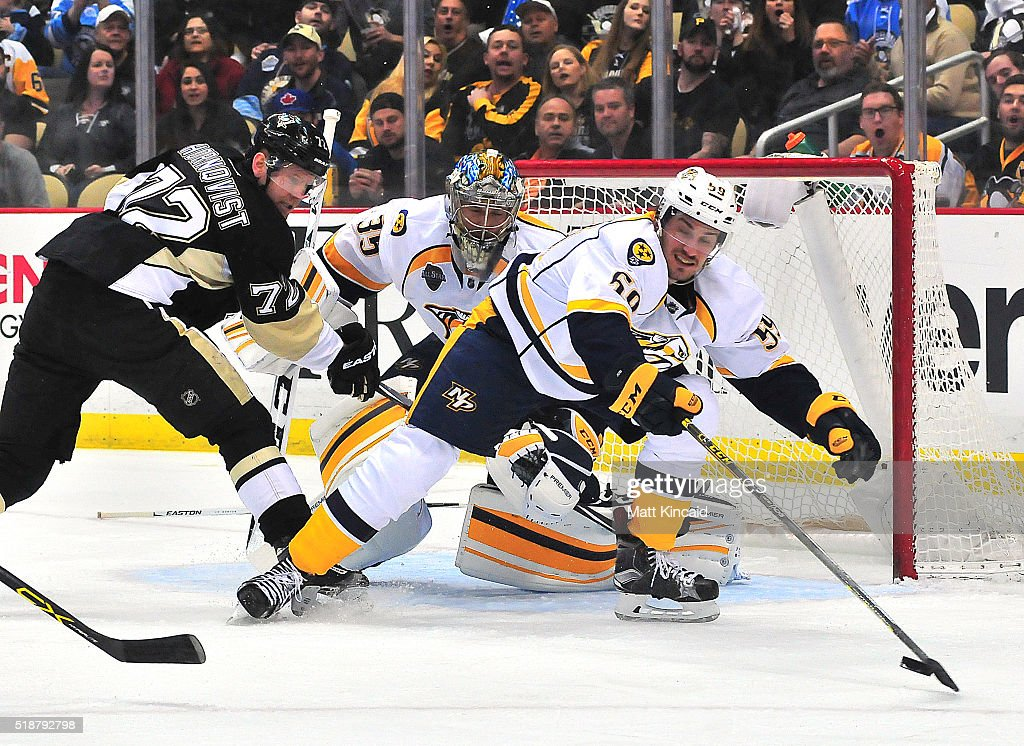 Roman Josi #59 of the Nashville Predators reaches for the puck in front of the goal against the Pittsburgh Penguins at Consol Energy Center on March 31, 2016 in Pittsburgh, Pennsylvania.