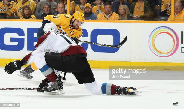 Roman Josi of the Nashville Predators shoots the puck against Nikita Zadorov of the Colorado Avalanche in Game Five of the Western Conference First...