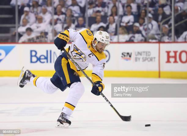 Roman Josi of the Nashville Predators shoots the puck down the ice during first period action against the Winnipeg Jets in Game Three of the Western...