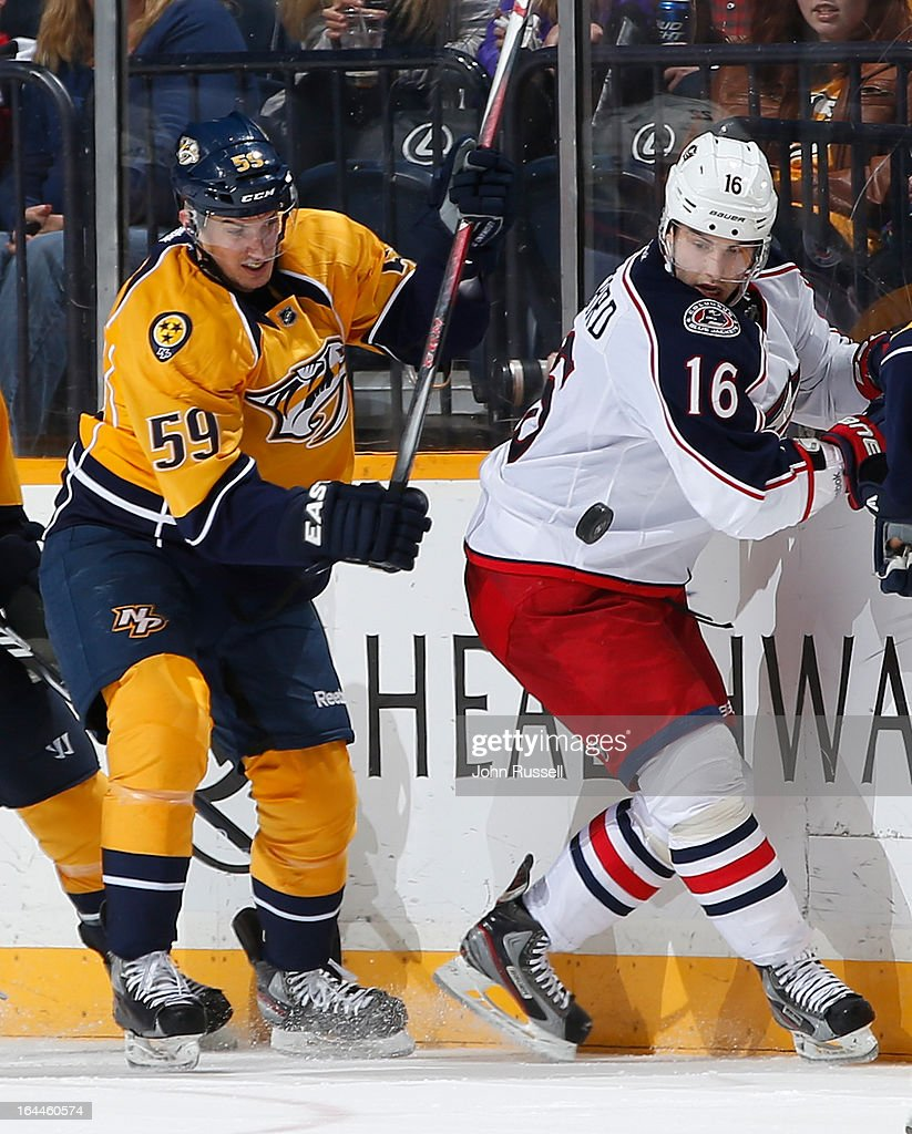 Roman Josi #59 of the Nashville Predators skates against Derick Brassard #16 of the Columbus Blue Jackets during an NHL game at the Bridgestone Arena on March 23, 2013 in Nashville, Tennessee.
