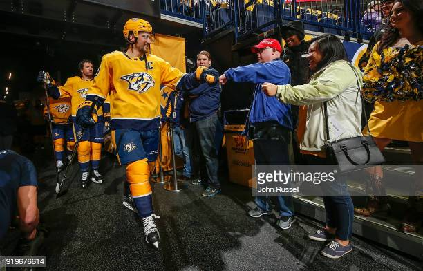 Roman Josi of the Nashville Predators taps fists with his Best Buddy Chris White prior to an NHL game against the Detroit Red Wings at Bridgestone...