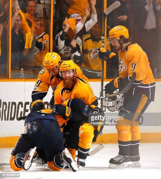 Roman Josi Ryan Ellis and Filip Forsberg of the Nashville Predators congratulate teammate James Neal on scoring a goal against the St Louis Blues...