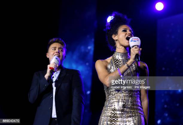 Roman Kemp and Vick Hope on stage during day one of Capital's Jingle Bell Ball with CocaCola at London's O2 Arena PRESS ASSOCIATION Photo Picture...