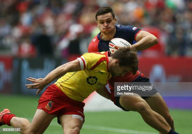 Roman Khodin of Russia is tackled by Pablo Fontes of Spain during the Canada Sevens the Sixth round of the HSBC Sevens World Series at the BC Place...