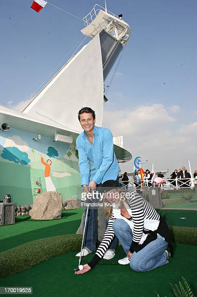 Roman Knizka And girlfriend Stefanie Mensing On On The miniature golf course on the Freedom Of The Seas In Hamburg port 240406