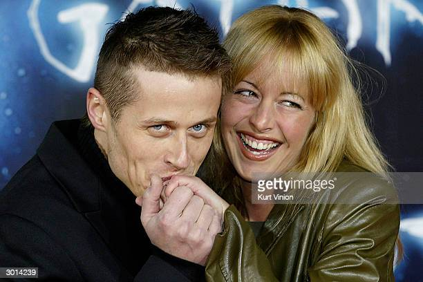 Roman Knizka and his girlfriend attend the German premiere of Gothika with Halle Berry February 25, 2004 in Berlin, Germany.