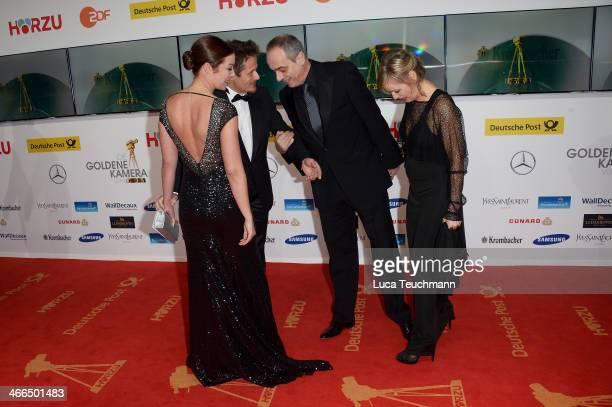 Roman Knizka Stefanie Knizka Christian Rach and Andrea Rach attend the 49th Golden Camera Awards at Tempelhof Airport on February 1 2014 in Berlin...