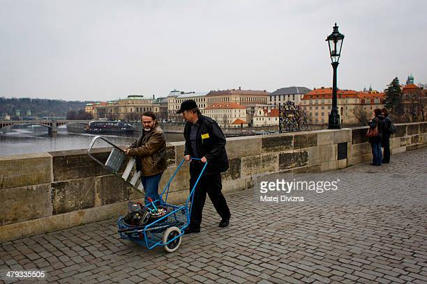Roman Kotrc from Charles Bridge Artists Association and security guard leave with removing love padlocks from Charles Bridge on March 18 2014 in...