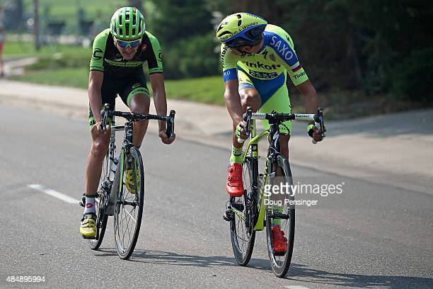 Roman Kreuziger of Czech Republic riding for Tinkoff-Saxo looks over his shoulder at Nathan Brown of United States riding for Cannondale-Garmin as...