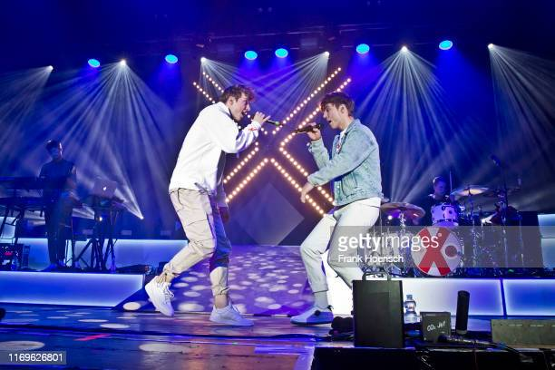 Roman Lochmann and Heiko Lochmann of the German duo Die Lochis perform live on stage during a concert at the Columbiahalle on September 19, 2019 in...