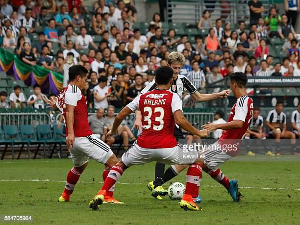 Roman Macek of Juventus FC surrounds by Leung Kwun Chung Leung Nok Hang and Law Hiu Chung of South China during the match between Juventus FC and...