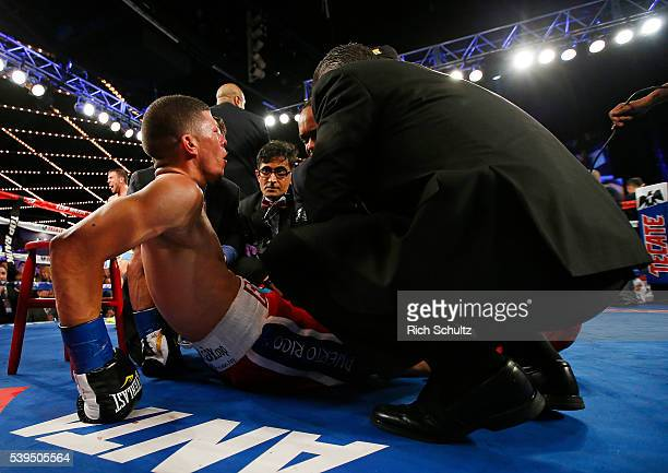 Roman Martinez is attended to by medical personal after being knocked out by Vasyl Lomachenko during the fifth round of their Junior Lightweight WBO...
