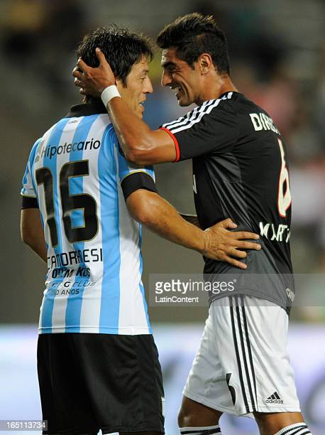 Roman Martinez of Estudiantes de La Plata fights for the ball with Mauro Camoranesi of Racing Club during a match as part of the 7th round of the...