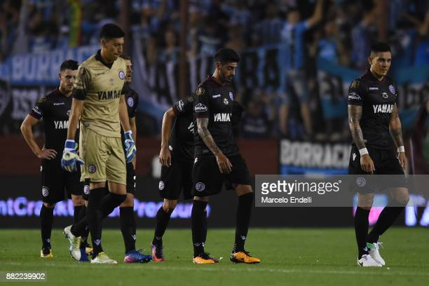 Roman Martinez of Lanus and teammates look dejected as they walk off the field at halftime during the second leg match between Lanus and Gremio as...