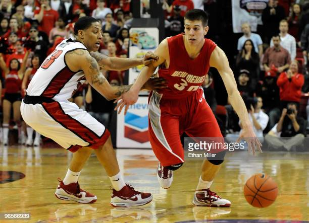 Roman Martinez of the New Mexico Lobos drives against Tre'Von Willis of the UNLV Rebels during their game at the Thomas & Mack Center February 10,...