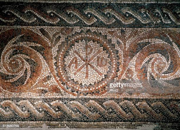 Roman mosaic depicting the ChiRho symbol with alpha and omega Found in Barcelona Museum of History Barcelona Spain