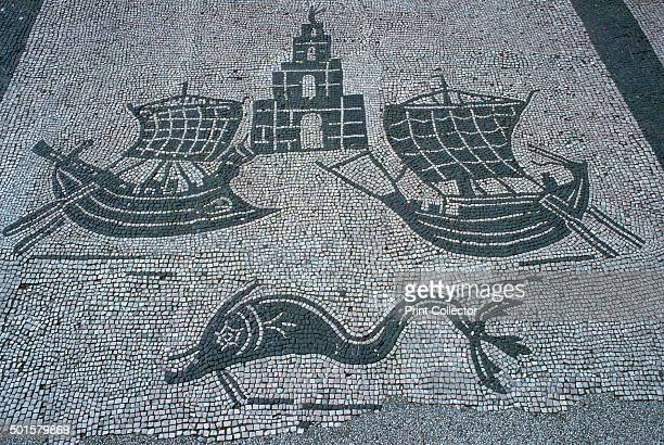 Roman mosaic of two ships a light house and a dolphin from the Square of the Corporations in Ostia 2nd century