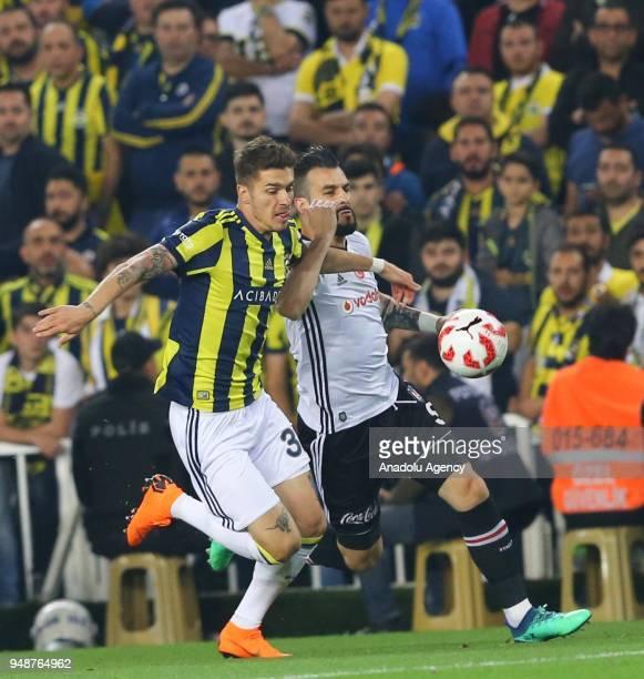 Roman Neustadter of Fenerbahce in action against Alvaro Negredo of Besiktas during Ziraat Turkish Cup Semi Final second leg soccer match between...