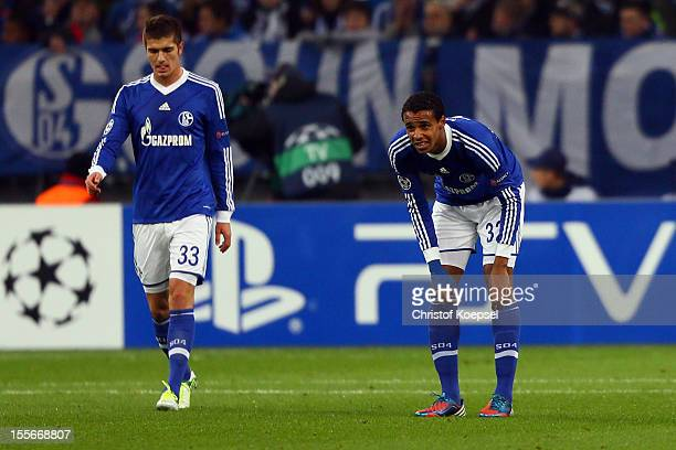Roman Neustaedter and Joel Matip of Schalke look dejected after the first goal of Arsenal during the UEFA Champions League group B match between FC...