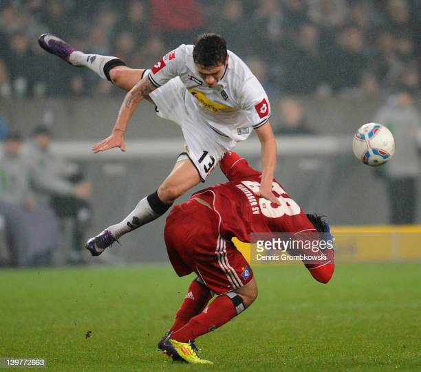 Roman Neustaedter of Moenchengladbach challenges Tolgay Arslan of Hamburg during the Bundesliga match between Borussia Moenchengladbach and Hamburger...