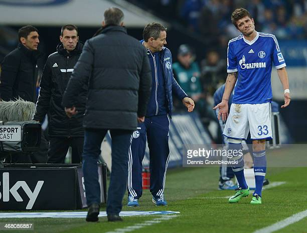 Roman Neustaedter of Schalke 04 reacts after suffering an injury during the Bundesliga match between FC Schalke 04 and Hannover 96 at VeltinsArena on...