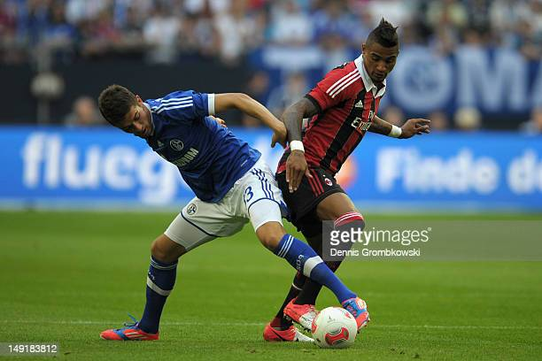 Roman Neustaedter of Schalke and KevinPrince Boateng battle for the ball during the friendly match between Schalke 04 and AC Milan at VeltinsArena on...