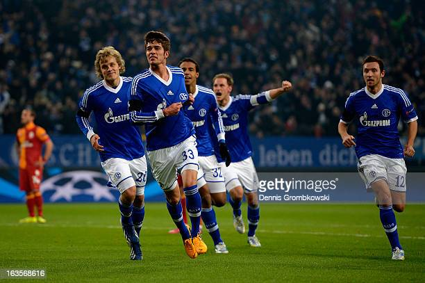 Roman Neustaedter of Schalke celebrates after scoring his team's first goal during the UEFA Champions League round of 16 second leg match between...