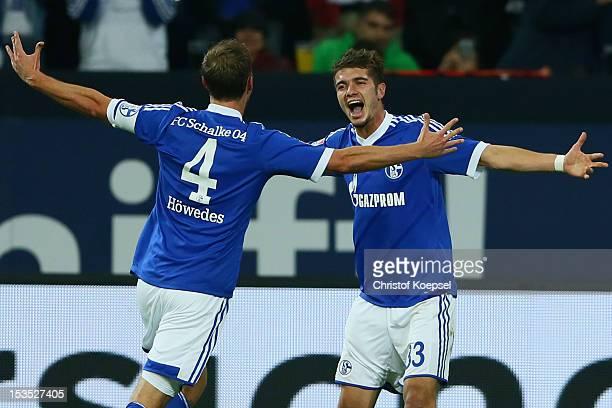 Roman Neustaedter of Schalke celebrates the third goal with Benedikt Hoewedes during the Bundesliga match between FC Schalke 04 and VfL Wolfsburg at...