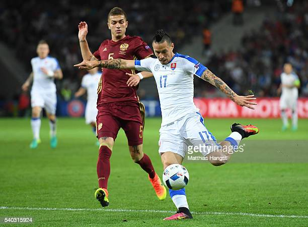 Roman Neustädter of Russia closes down Marek Hamsik of Slovakia during the UEFA EURO 2016 Group B match between Russia and Slovakia at Stade...