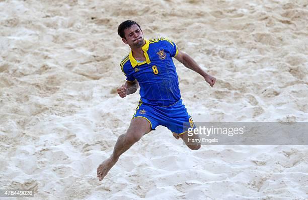 Roman Pachev of Ukraine celebrates during the Men's Beach Soccer Group A match between Portugal and Ukraine on day thirteen of the Baku 2015 European...