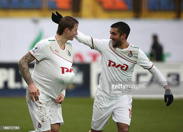 Roman Pavlyuchenko and Aleksandr Samedov of FC Lokomotiv Moscow celebrate after scoring a goal during the Russian Premier League match between FC...