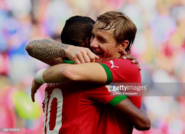 Roman Pavlyuchenko and Maicon of FC Lokomotiv Moscow celebrates after scoring a goal during the Russian Premier League match between FC Lokomotiv...