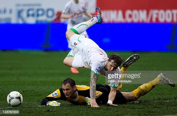 Roman Pavlyuchenko of FC Lokomotiv Moscow battles for the ball with Sergei Ryzhikov of FC Rubin Kazan during the Russian Football League Championship...