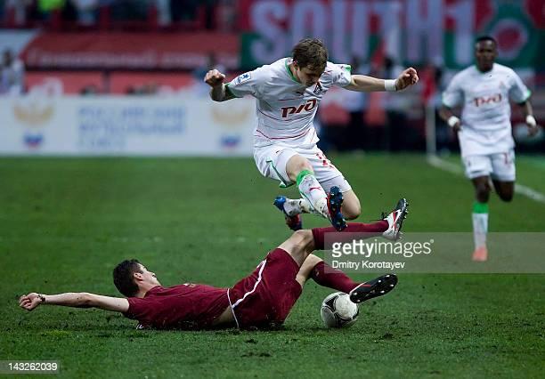 Roman Pavlyuchenko of FC Lokomotiv Moscow battles for the ball with Solomon Kvirkvelia of FC Rubin Kazan during the Russian Football League...