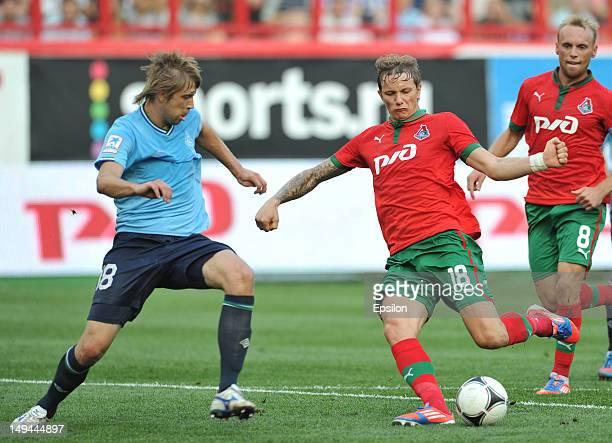 Roman Pavlyuchenko of FC Lokomotiv Moscow battles for the ball with Dmitry Verkhovtsov of FC Krylia Sovetov Samara during the Russian Premier League...