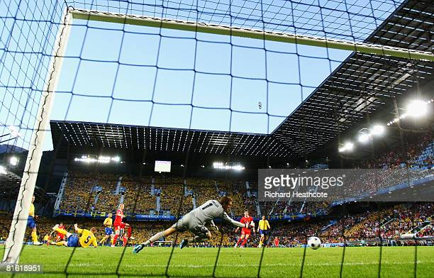 Roman Pavlyuchenko of Russia scores the opening goal during the UEFA EURO 2008 Group D match between Russia and Sweden at Stadion Tivoli Neu on June...