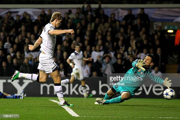 Roman Pavlyuchenko of Spurs shoots past goalkeeper Luca Castellazzi of Inter Milan to score his team's third goal during the UEFA Champions League...