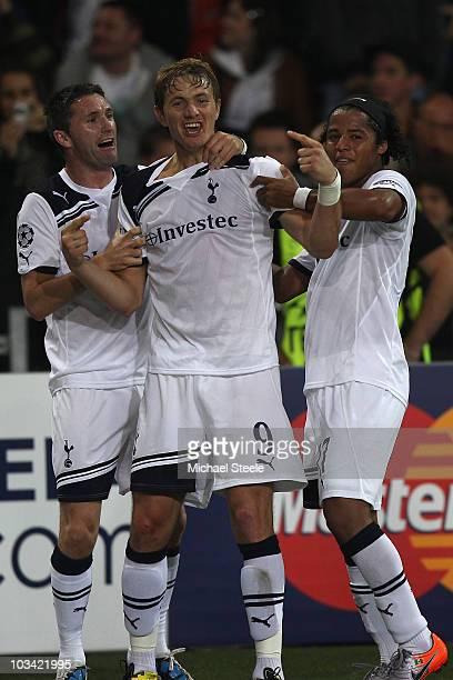 Roman Pavlyuchenko of Tottenham celebrates scoring his sides second goal with Robbie Keane and Giovani dos Santos during the UEFA Champions League...