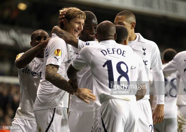 Roman Pavlyuchenko of Tottenham Hotspur celebrates with team mates after scoring from a free kick during the UEFA Europa League Group A match between...
