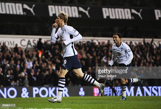 Roman Pavyluchenko of Tottenham celebrates after scoring the opening goal during the Carling Cup fourth round match between Tottenham Hotspur and...