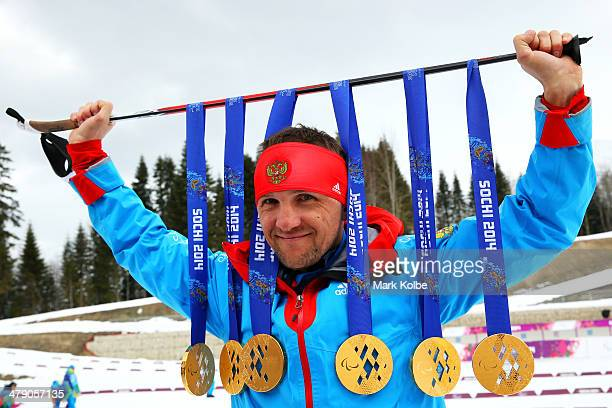 Roman Petushkov of Russia poses with the six gold medals won during the Sochi 2014 Paralympic Winter Games at Laura Cross-country Ski and Biathlon...