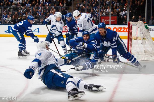 Roman Polak and Dominic Moore of the Toronto Maple Leafs battle with Ryan Callahan of the Tampa Bay Lightning during the first period at the Air...