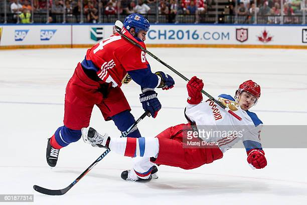 Roman Polak of Czech Republic and Artemi Panarin of Russia battle for the puck during the 2016 World Cup of Hockey preparation match between Czech...