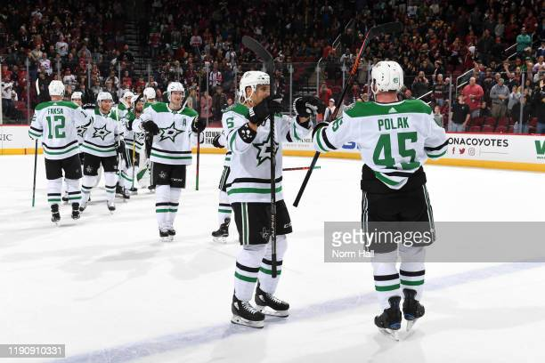 Roman Polak of the Dallas Stars congratulates Andrej Sekera and teammates following a 4-2 victory against the Arizona Coyotes during the NHL hockey...