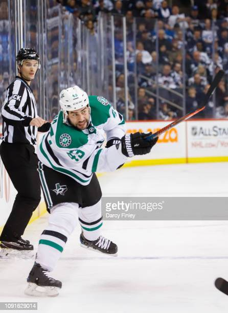 Roman Polak of the Dallas Stars shoots the puck down the ice during third period action against the Winnipeg Jets at the Bell MTS Place on January 6...