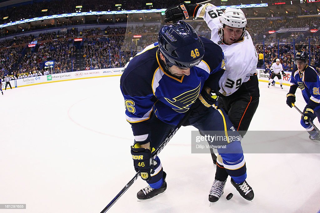 Roman Polak #46 of the St. Louis Blues fights off Matt Beleskey #39 of the Anaheim Ducks for control of the puck at the Scottrade Center on February 9, 2013 in St. Louis, Missouri.