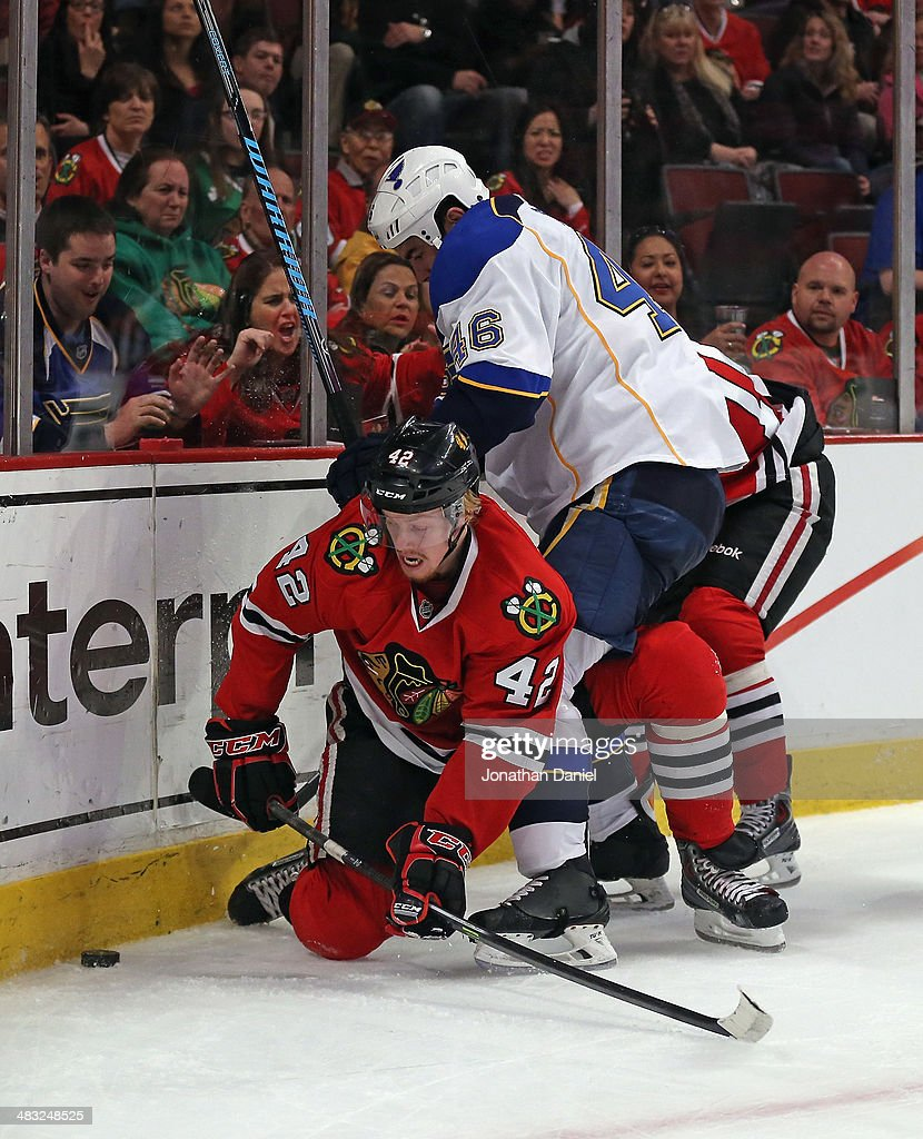 Roman Polak #46 of the St. Louis Blues tries to hold back Joakim Nordstrom #42 of the Chicago Blackhawks with his leg as they battle for the puck at the United Center on April 6, 2014 in Chicago, Illinois. The Blackhawks defeated the Blues 4-2.